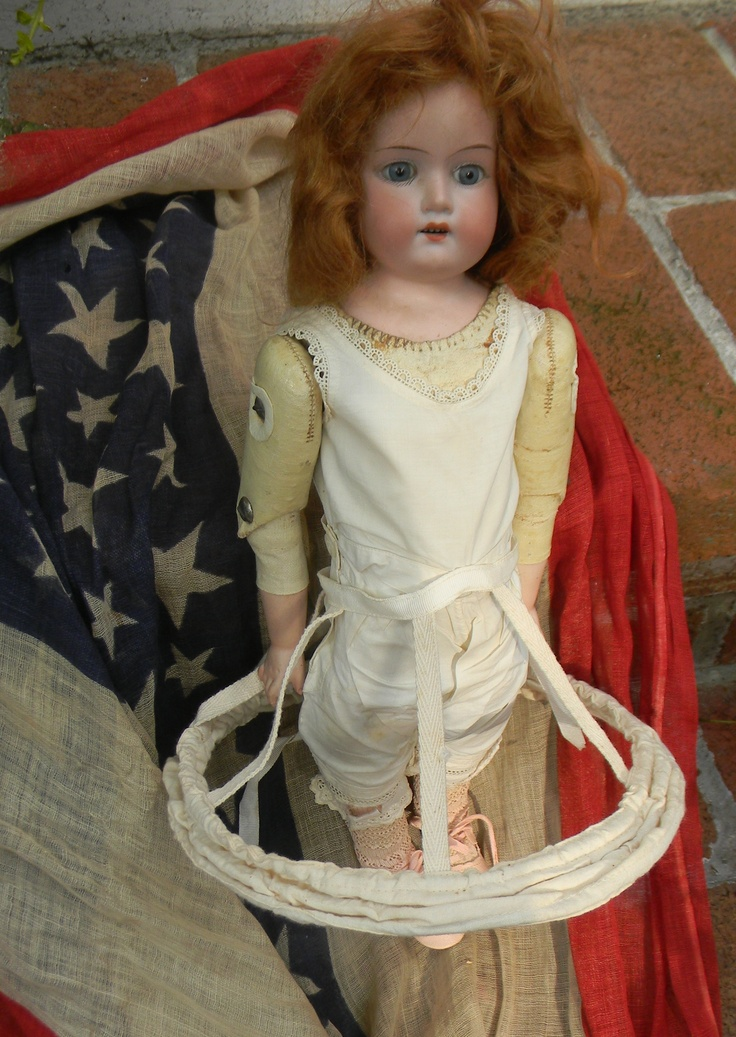Antique Doll in a hoop skirt