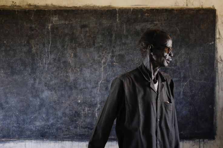 Goran Tomasevic—Reuters An elderly man walks out of a polling station located in a school during a referendum in the town of Abyei.