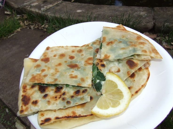 Muttabag, a yemeni appetizer, made with a thin type of dough and it has tomatoes, meat,