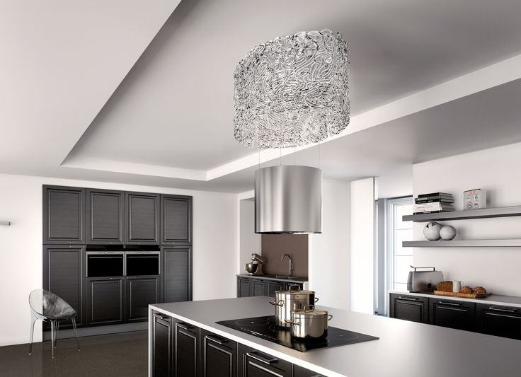 With an original and unique design, the Nest hood, belonging to F-light line up, reflects the typical streaked form of a bird's nest: the body is formed by the lamp itself which is all glass, which in turn contains the extractor hood, amplifying and reflecting the light.