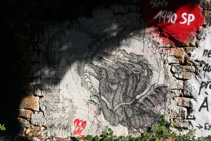 the abode of chaos, near Lyon's area, France; dragon (hydra) painting on a wall