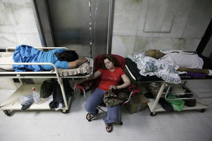 IN THE MIDDLE: A woman slept in between patients suffering from dengue fever at a hospital in Tegucigalpa, Honduras, Monday. Local media have reported thousands of confirmed cases and several deaths. (Jorge Cabrera/Reuters)