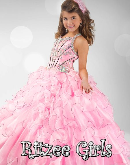 Size 10 Pink/Black In StockSpectacular Ritzee Girls Pageant Dress 6343. This floor length pageant gown features a halter neckline, gorgeous beaded and embroidered bodice, and a beaded keyhole in the back. Completing the look of this dress is a ruffled ball gown skirt. This amazing dress will make your girl feel like a princess. Available Pink/Blue, Pink/Neon Pink, Purple and White.