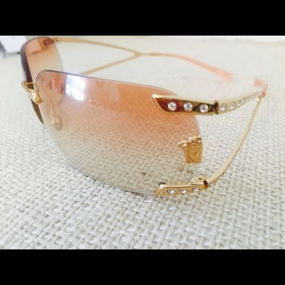 Sale!! Authentic Versace Sunglasses Rose tint Versace sunglasses with rhinestone detail excellent condition never worn. I have box too. Versace Accessories Sunglasses