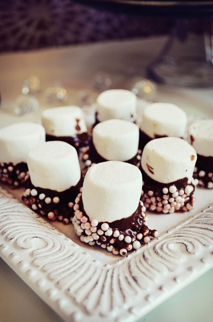 Shabby chic baby shower food.Chocolate dipped marshmallows with pearl sprinkles.