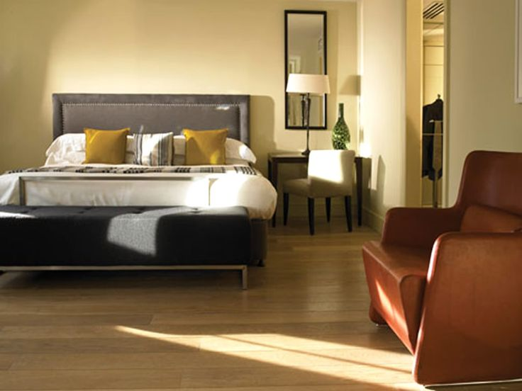 Contemporary Bedroom Interior With Wooden Flooring Also Single Brown Leather Bedroom Sofa Design And Gray Wooden