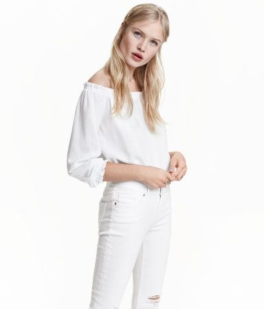 White. Waist-length blouse in woven crêpe fabric with elastication at top, cuffs, and hem.