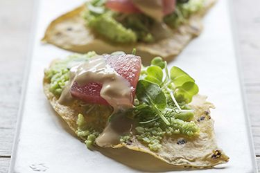 Tortilla crisps with edamame puree and sashimi