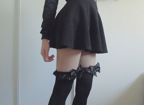 Black ruffle dress with thigh-high black bow socks