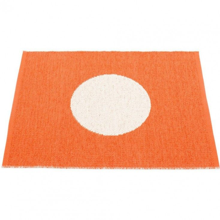 The Pappelina Vera Small One mat features a large vanilla spot on an orange background. Fancy a change? Flip it over and the design is reversed.  This bestselling Pappelina mat is traditionally made from woven plastic, making it ideal for the bathroom, kitchen, utility room, or as a welcoming door mat.   Pappelina mats, runners and rugs  are reversible, dust and dirt repellent, and fully washable, although a quick vacuum is probably all they will ever need to keep them looking good as new.
