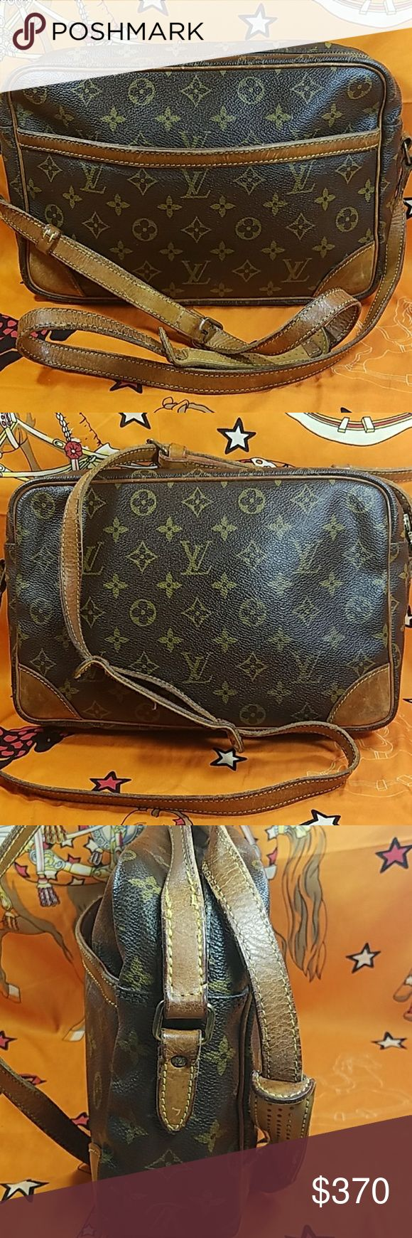 "Authentic Louis Vuitton Monogram Trocadero 30 The outer leather has some white spots around. The leather trims and (about)55"" long adjusable strap showed sign of used with stains, scratches &darkened (3rd photo). Inside showed wearing also with pen marks, stains, & scratches. There is bubbles inside outer pocket ( 4th photo). Date code: 882TH. It made in France. Dimension: (about) 7.5, 11, & 3. No trade please. Louis Vuitton Bags Crossbody Bags"