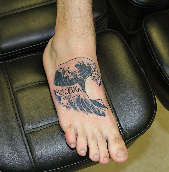 The great wave foot tattoo by derek wicked parrot tattoo for Wave tattoo on foot