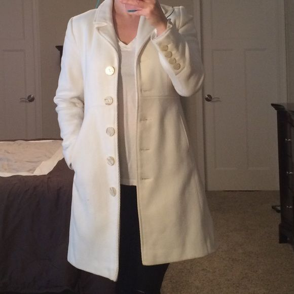 Old Nav, size S, ivory button down coat Old Nav, size S, ivory button down coat. Button detail on sleeves. Two front pockets. Very small snag on bottom left front of jacket (see last picture). Bundle items for a discount! Old Navy Jackets & Coats Pea Coats