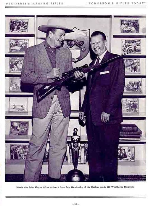 THE CREAM OF THE CROP - John Wayne accepts a custom-made .300 Weatherby Magnum rifle from Roy Weatherby, President of Weatherby Magnum Rifles.