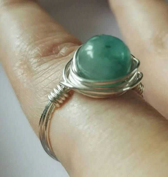 A beautiful wire wrapped semi precious gemstone ring. Each ring is made to order so they are slightly different every time and completely unique! I have used a 8mm jade bead which has been hand dyed teal and wrapped it in 0.6mm copper wire which is available silver or rose gold plated