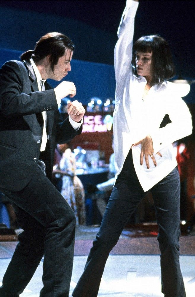Channel your inner Pulp Fiction with crispy button down shirt, pants, and black wig with bangs.