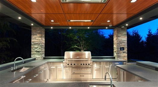 A Very Elegant Outdoor Kitchen And Bbq Area