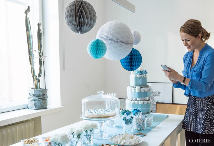 It's a boy! Decoration ideas for a baby shower.  A classic diaper cake was the centerpiece of the table. <3 A home-made white chocolate cheese case was everybody's favorite. :) And honeycomb paper balls gave the final touch for the decoration!   Katriina taking picture and updating her SoMe accounts. :)  Check out the whole blog post here: http://www.coterie.fi/baby-shower-for-a-boy-vauvakutsut-pojalle/