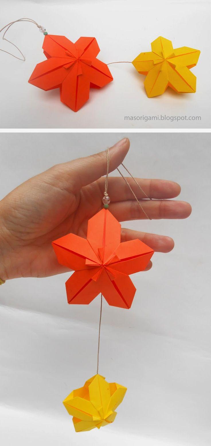 origami - móvil realizado con dos flores modulares plegadas en papel