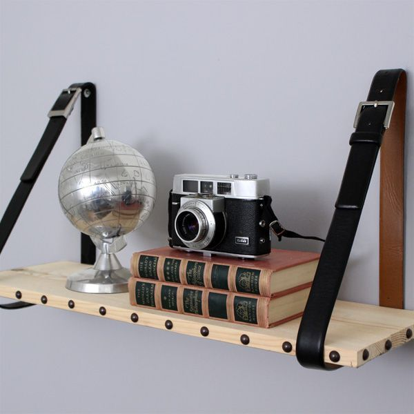 Leather and Wood Suspended Shelf. Upcycled leather belts and a scrap of wood create an easy yet dapper shelving solution.