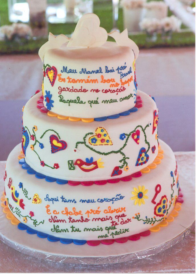 "Lovers cake... typical Portuguese cake from Viana do Castelo northen Portugal, in this wedding cake the bride and groom express their feelings to each other through love poems...the bottom verse ""Here you have my heart, And the key to open it, I don't have more to offer you, And you have nothing else to ask of me"""
