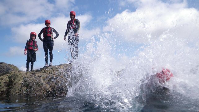 Making a big splash during a family coasteering trip in Pembrokeshire