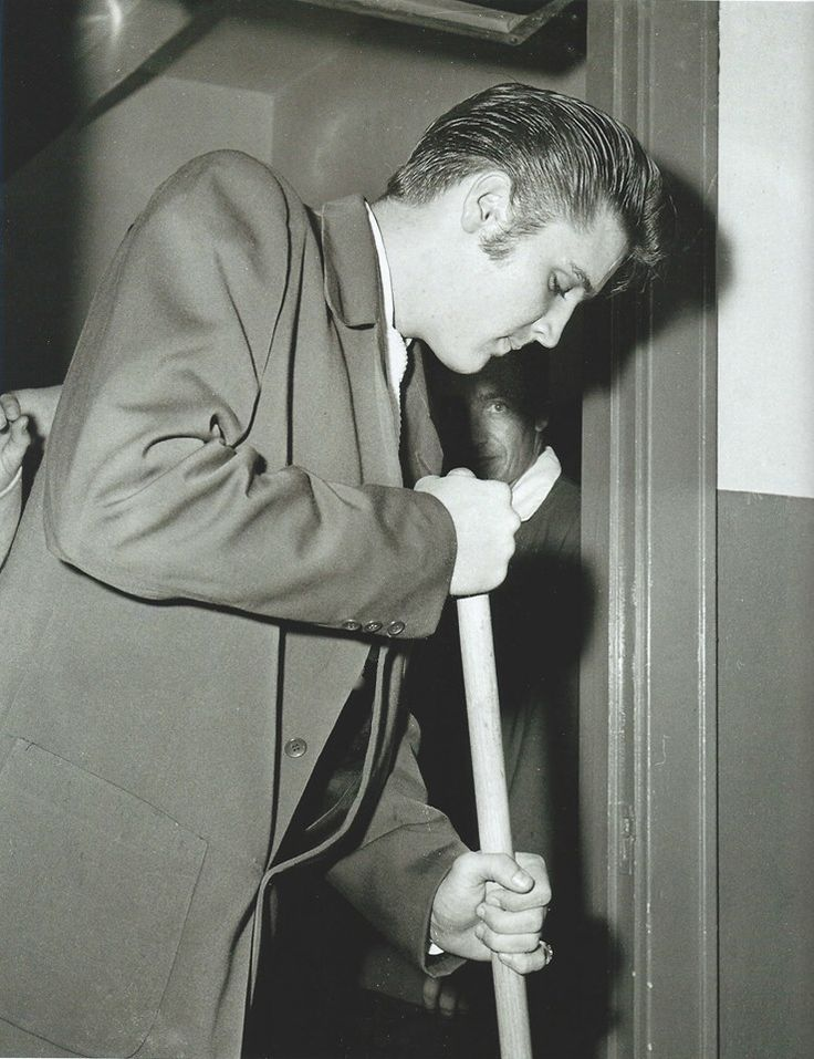 """Fort Homer Hesterly Armory, Tampa, FL, Sunday, August 5, 1956   """"Dressed as sharp as a cat in black pegged pants, striped belt, blue shirt, white tie, maroon jacket and white buck shoes, the king of rock n' roll picked up a broom and started sweeping out his dressing room..."""" Read more: http://www.elvisconcerts.com/newspapers/press165.htm"""