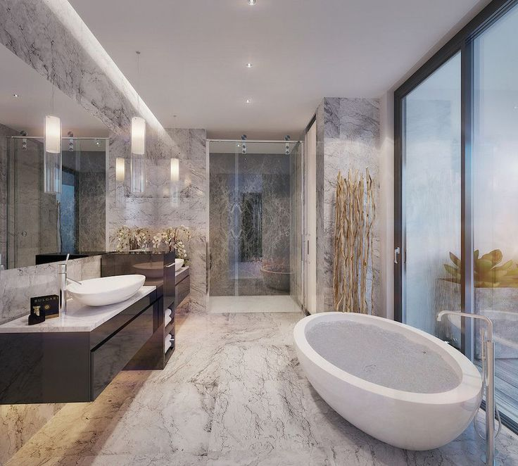 This luxurious bathroom with a stunning outdoor connection was completed by Michael Beamish Design Group. #luxeFL