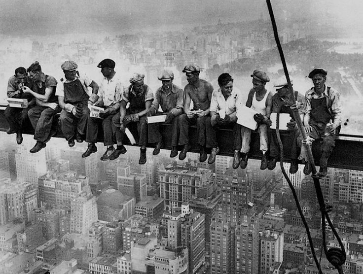 a famous 1932 photo by fearless photographer Charles C. Ebbets with workmen eating lunch on the 69th floor of the GE Building during the construction of Rockefeller Center.