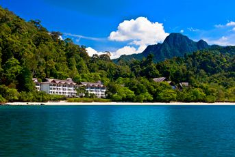 The Andaman, Langkawi. Nestled between an ancient rainforest and a pristine private beach, this stylish oasis is home to rare fauna, flora, and a coral reef.