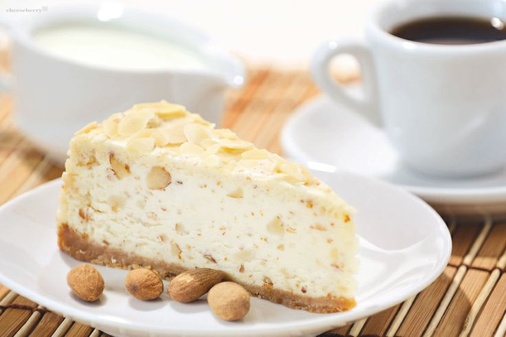 Nuts Cheesecake  One of the best variations of the classical vanilla cheesecake. Adding almonds' petals gives an aristocratic spicy to creamy taste the tender filling.