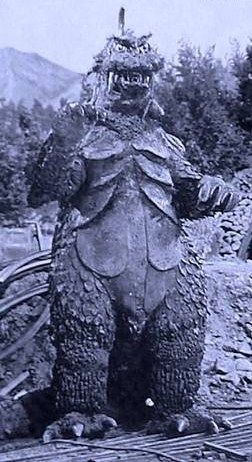 The monster Gomess from Ultra Q. The monster was brought to life with a modified Godzilla suit from the films Mothra vs Godzilla and Ghidorah the Three Headed Monster.