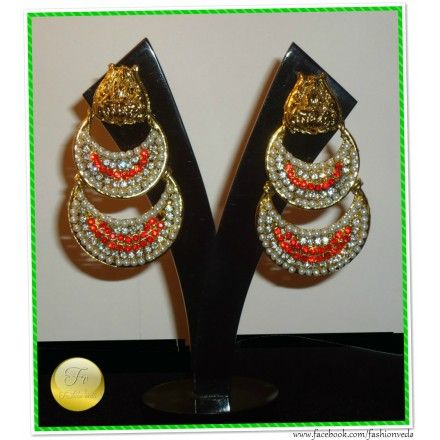 Exquisite Chand earrings in dangler style.  	Material- Pearls,Crystals  	Color- Orange, Golden & White  	Care- Protect from moisture.  	Storage- Keep in an airtight pouch.