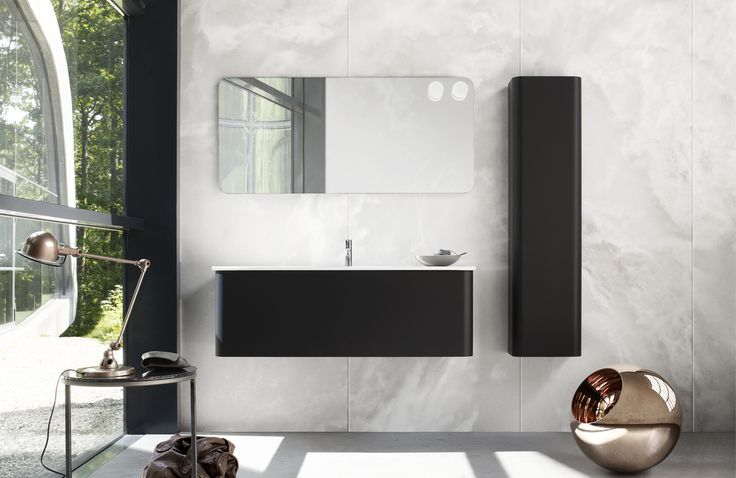 Round and round with Dansani Curvo - beautifully curved bathroom furniture.