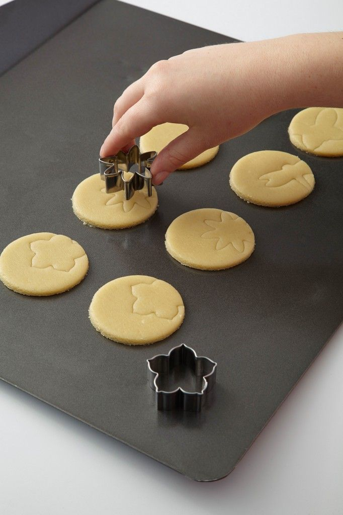 Lightly press the  shape into the dough to create baked-in designs that are easy to trace with a piping bag.