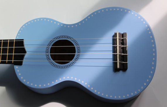 One row of white dots, front and back, add just a little bit of flair to this pretty light blue ukulele. For sale on Etsy.