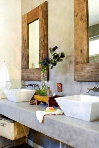 concrete counters / stone basins / reclaimed wood mirrors - love for a master bathroom.   The mirrors! <3
