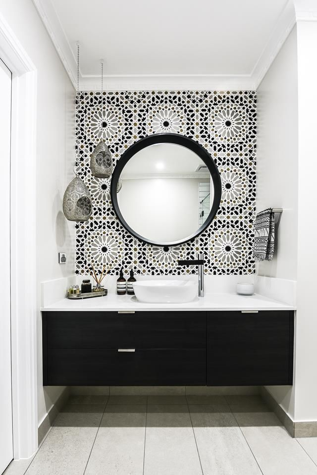 In this Melbourne bathroom, a Moroccan inspired Schumacher wallpaper called Nasr…