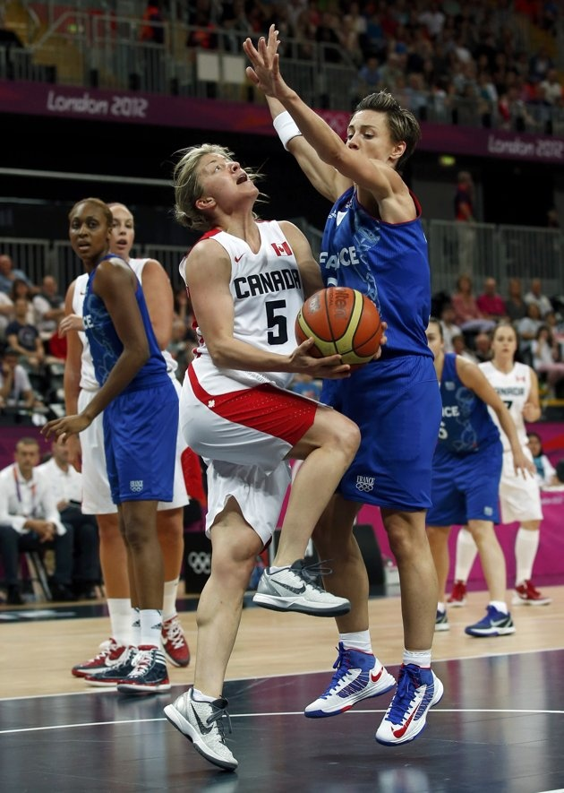 Canada's Teresa Gabriele (L) goes to the basket against France's Celine Dumerc during the women's preliminary round Group B basketball match at the Basketball Arena during the London 2012 Olympic Games August 1, 2012. REUTERS/Sergio Perez (BRITAIN - Tags: SPORT OLYMPICS SPORT BASKETBALL)