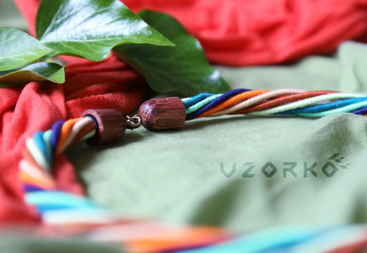 Multistrand necklace. Colorful cotton and wool, brass and wooden elements.