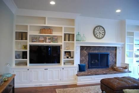 tv next to a fireplace