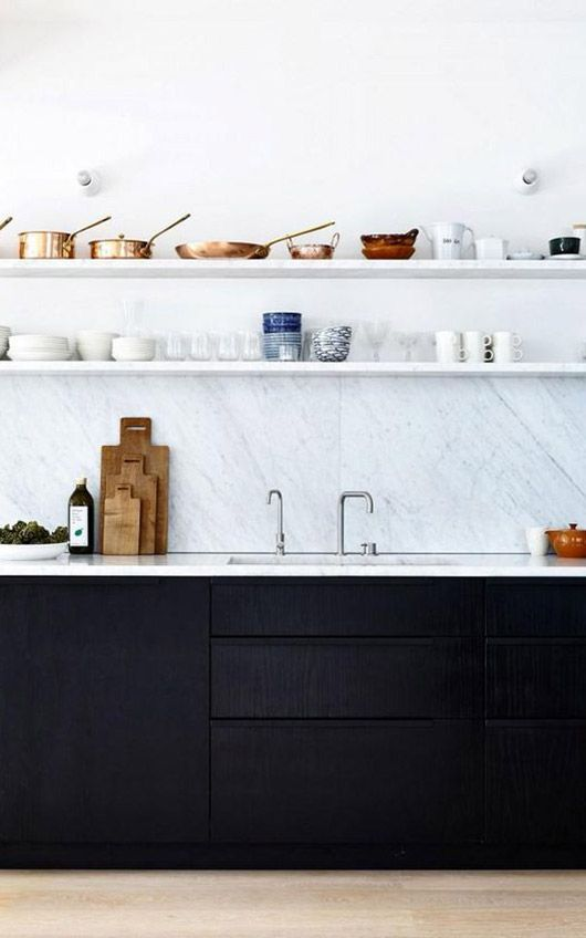 marble kitchen countertops and backsplash and open shelves with black cabinets below / sfgirlbybay