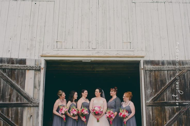 Bride and her bridesmaids in a barn