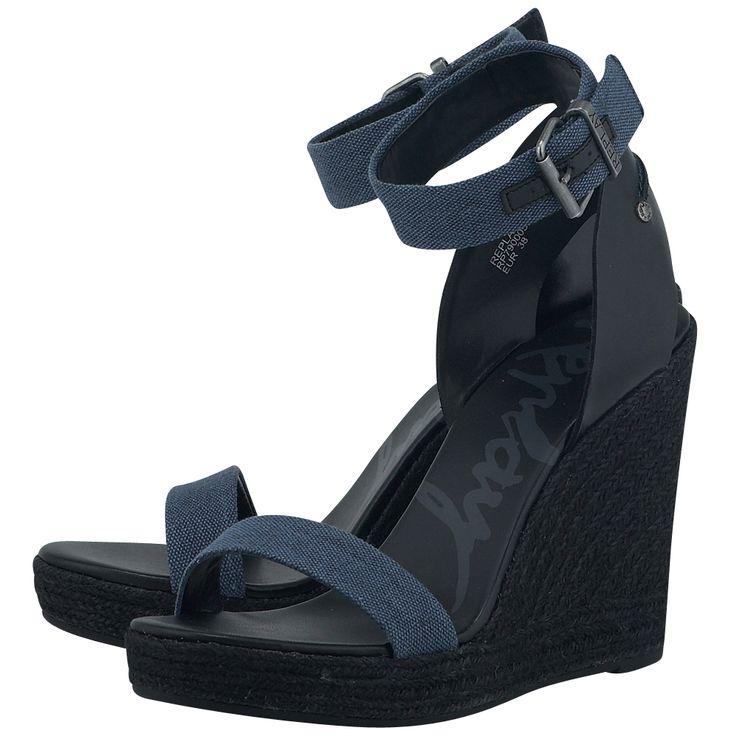 Γυναικεία πέδιλα πλατφόρμες από δέρμα σε συνδυασμό με denim ύφασμα, με εσωτερική επένδυση από συνθετικό δέρμα και ενιαίο τακούνι ύψους 11 cm με φιάπα 2 cm για να εξισορροπεί το ύψος του. Σε γκρι με μαύρο χρώμα, ankle-strap παπούτσια που κολακεύουν το πόδι και παίζουν με τη θηλυκότητά σας.  # H Replay καινοτομεί και σχεδιάζει μοντέρνα παπούτσια για πρωτότυπες, στυλάτες εμφανίσεις.