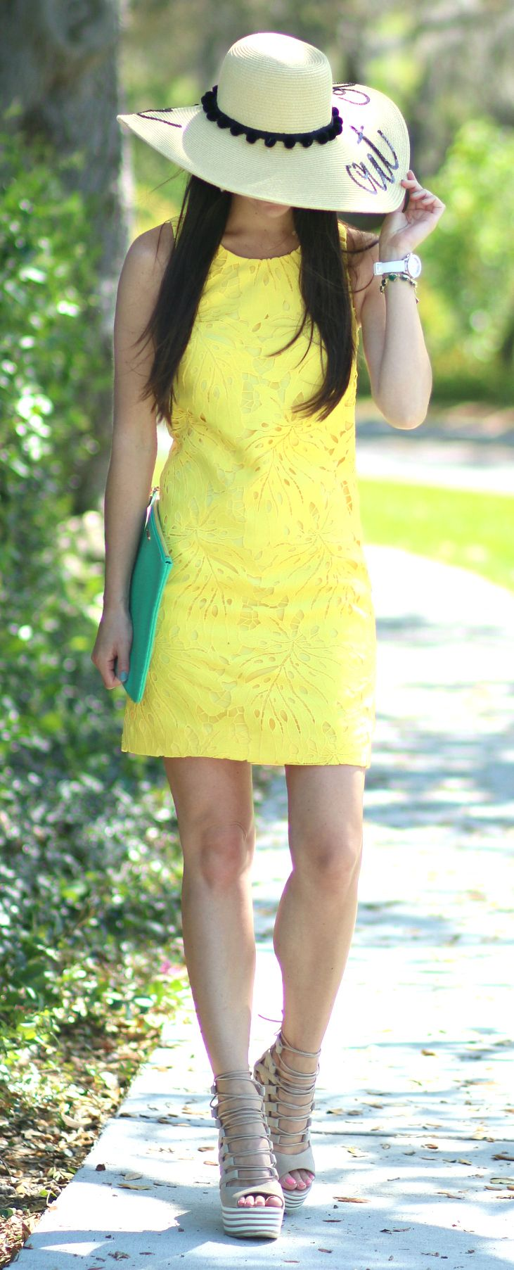 Banana Republic yellow lace shift dress with gladiator wedges, a green GiGi New York Uber clutch, and an Out of Office floppy sun hat... fun office outfit idea that can be dressed up or down with different shoes and accessories | Banana Republic Summer Style: Yellow Leaf Pattern Shift Dress by Stephanie Ziajka from Diary of a Debutante