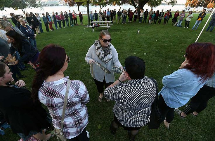 Melissa Thomas makes her way around a circle while burning sage for a smudging ritual in Dieppe Park as part of the 11th annual National Sisters in Spirit Vigil for the murdered indigenous women across Canada in Windsor on Tuesday, October 4, 2016. The annual event seeks to raise awareness of missing and murdered women.