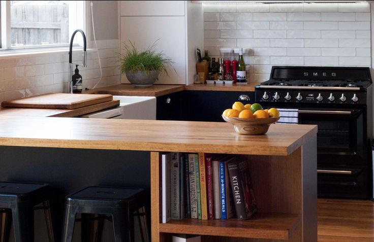 Another great example of how to maximise space. A little shelving nook like this is perfect for those cookbooks and feature items that bring your personality into the room. Also love seeing the clever use of the sink cutout to provide more working space for compact kitchens. Nice one, Baseplate Design.  Follow us on Instagram @timberrevival or visit our website for more information http://www.timberrevival.com.au - #timberrevival #recycledtimbermelbourne #custom #joinery #kitchendesign…