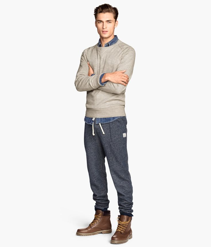 Keep it casual in some dark blue sweatpants with an elastic drawstring waistband. | H&M For Men