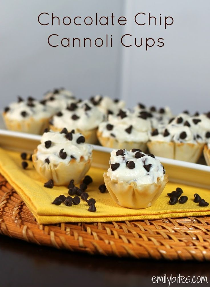 Chocolate Chip Cannoli Cups - these little cups are overflowing with sweet, creamy marscapone and ricotta cannoli filling packed with chocolate chips and nestled in flaky phyllo cups. These only take 10 minutes to make and are just 63 calories or 2 Weight Watchers points each! www.emilybites.com