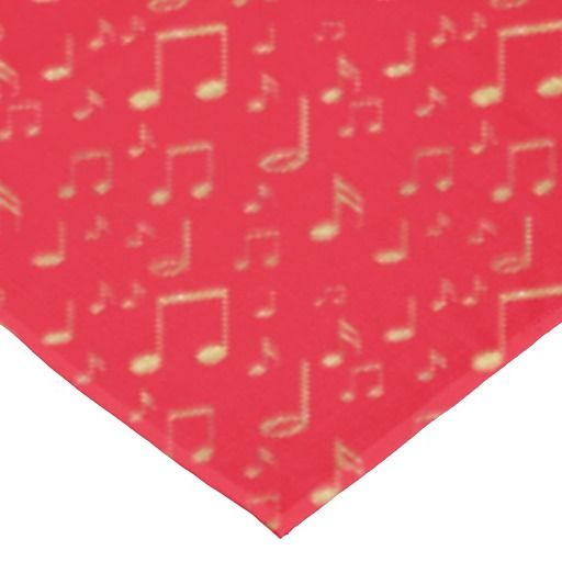 festive golden music on red tablecloth